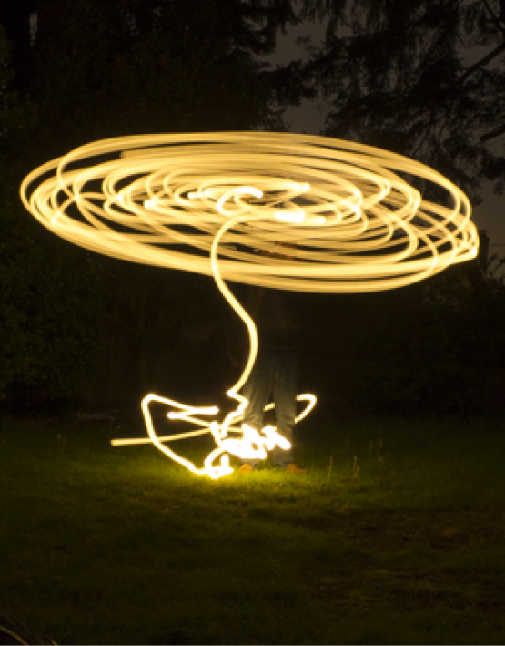 Light painting at night in the backyard